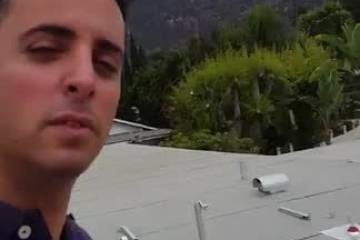 Solar pv installation on flat roof under the Hollywood sign
